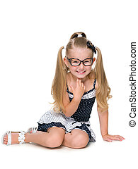 Laughing little girl sits