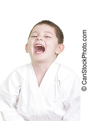 Laughing little karate kid photo against white background
