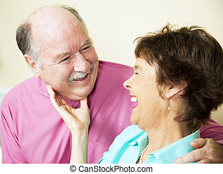 Laughing Loving Senior Couple - Beautiful senior couple in...