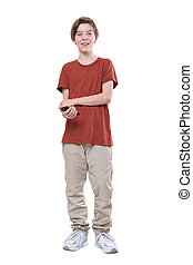 laughing male teenager with smart phone in one hand, isolated on white.