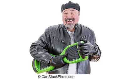 Laughing man holding hoverboard