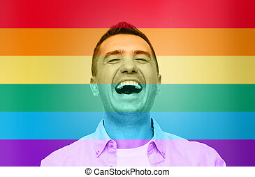 laughing man over rainbow flag stripes background