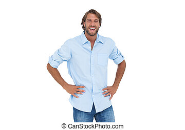 Laughing man with hands on hips
