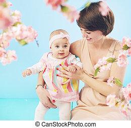 Laughing mom hugging her daughter