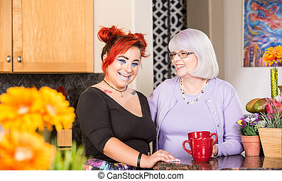 Laughing Mother and Daughter in Kitchen