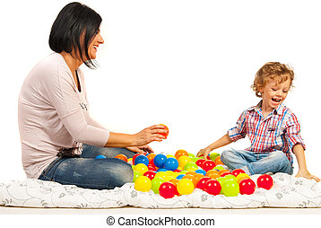 Laughing mother and son with balls