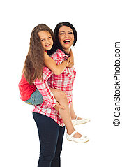 Laughing mother give piggyback to girl