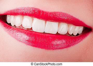 a smiling mouth with red lips and white teeth