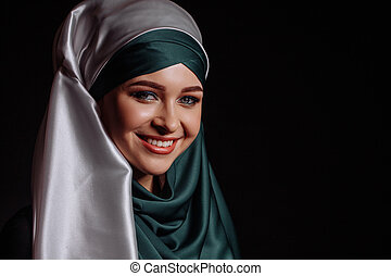 laughing Muslim girl in satin green hijab