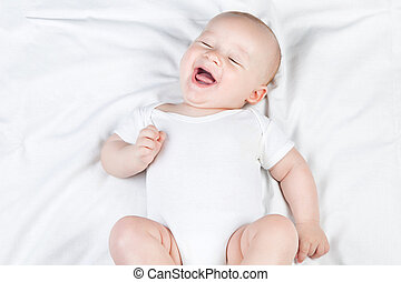 Laughing nursing baby