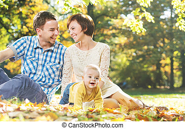 Laughing parents with cute child