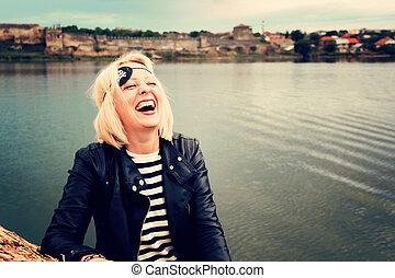 laughing pirate girl blonde. photo