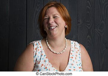 Laughing red head woman