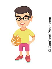 Laughing schoolboy holding a basketball ball.