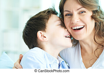 Laughing - Family of ecstatic mother and son laughing