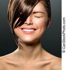 Laughing Teenage Girl with Closed Eyes. Stylish Fringe
