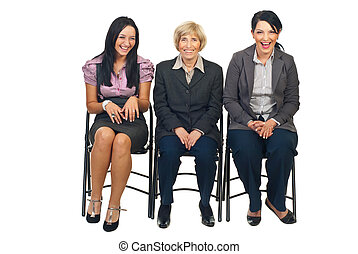 Laughing three business women on chair