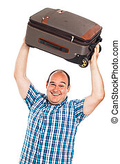 Laughing traveler lifting up his luggage