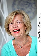 Laughing vivacious senior woman