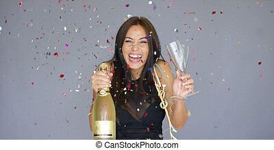 Laughing vivacious woman celebrating the New year with...