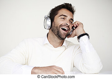 Laughing with headphones