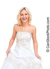 laughing woman in a wedding dress posing