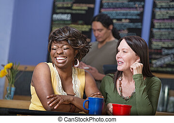 Laughing Woman in Cafe with Friend