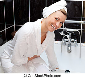 Laughing woman is having a bath