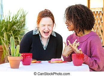 Laughing woman listening to friend