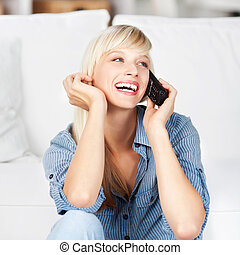 Laughing woman on phone