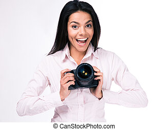 Laughing woman photographer with camera