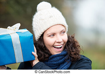 Laughing woman shaking her gift