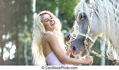 Laughing woman taking pictures of the horse