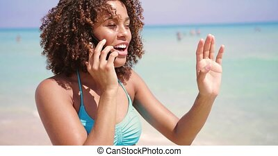 Laughing woman talking phone at seaside - Laughing young...