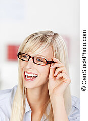 Laughing woman wearing glasses