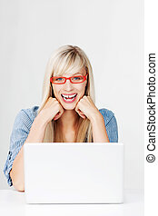Laughing woman wearing red glasses