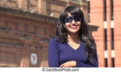 Laughing Woman Wearing Sunglasses And Wig