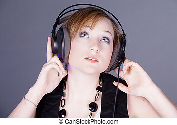laughing woman with headphones