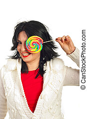 Laughing woman with lollipop