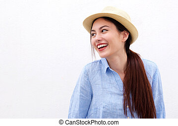 Laughing woman with long hair and hat on white background