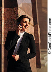 Laughing woman with mobile