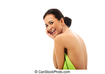 Laughing woman wrapped in towel