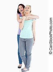 Laughing Women hugging