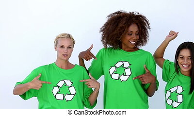 Laughing women with green ecologic t-shirt showing recycle...