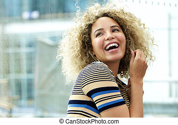 Laughing young african american woman
