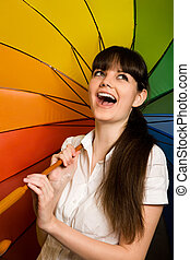 laughing young brunette woman in white blouse with...