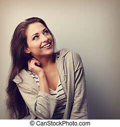 Laughing young casual woman looking up. Closeup vintage portrait