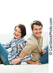 Laughing young couple having fun at home