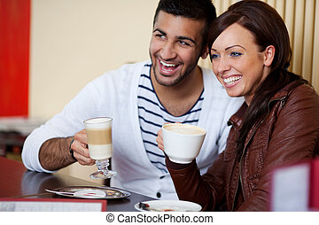 Laughing young couple in a restaurant