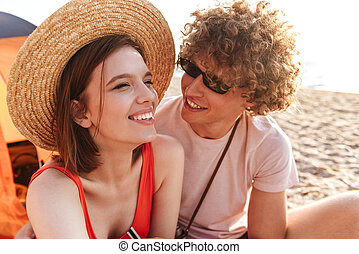 Laughing young couple sitting together